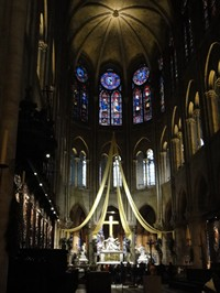 Notre Dame nave and altar with it's Pieta in  Notre Dame Cathedral / Cathédrale Notre-Dame de Paris  in Paris France