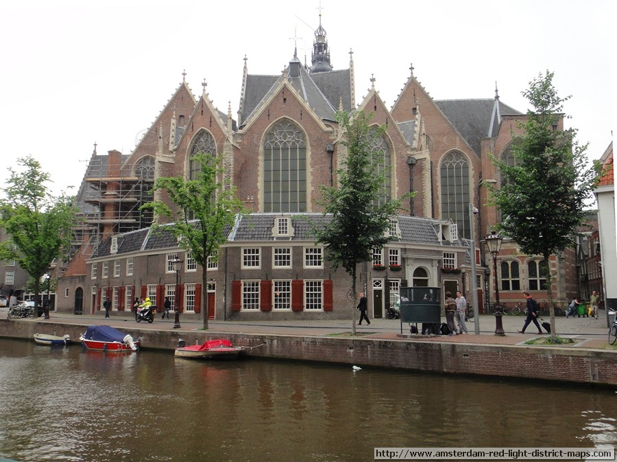 Oude Kerk in Amsterdam's red light district, Netherlands.