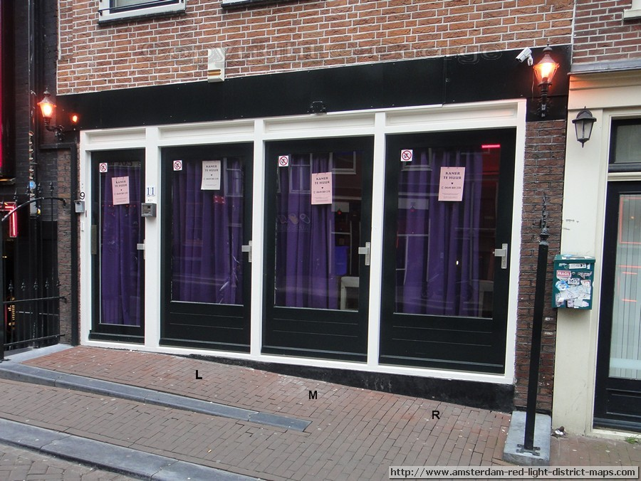 Oudezijds Achterburgwal, Amsterdam red light district (De Wallen / Walletjes / De Rosse Buurt). Copyright: George 2011
